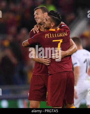 Rome, Italy. 2nd Oct, 2018. Edin Dzeko (L) celebrates scoring with Lorenzo Pellegrini of Roma during a group G match of UEFA Champions League between Roma and Viktoria Plzen, in Rome, Italy, Oct. 2, 2018. Roma won 5-0. Credit: Alberto Lingria/Xinhua/Alamy Live News - Stock Photo