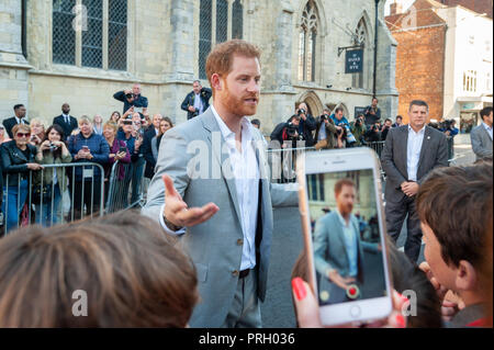 Chichester, West Sussex, UK. 3rd October 2018. The Duke of Sussex, Prince Harry talks with school children during his and Meghan Markle's visit to Chichester. Credit: Scott Ramsey/Alamy Live News - Stock Photo