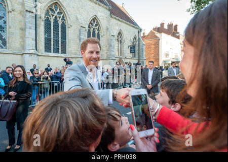 Chichester, West Sussex, UK. 3rd October 2018. The Duke of Sussex, Prince Harry shakes hands with a local school teacher during his and Meghan Markle's visit to Chichester. Credit: Scott Ramsey/Alamy Live News - Stock Photo