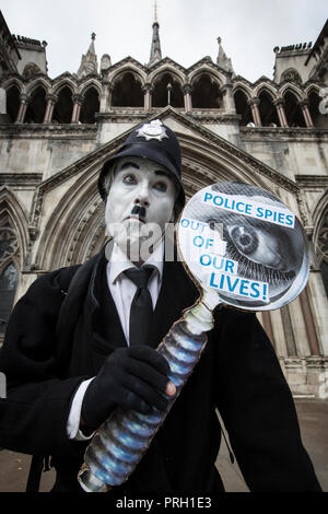 London, UK. 3rd Oct 2018. Protester Against Undercover Police Officers outside High Court, Royal Courts of Justice, London, UK 3rd October 2018. The public have been shocked that women have been deceived into intimate relationships with undercover police officers in the United Kingdom. One woman is bringing a case about the human rights abuses she suffered in her relationship with undercover police officer Mark Kennedy while he infiltrated social and enviromental campaign groups. Credit: Jeff Gilbert/Alamy Live News - Stock Photo