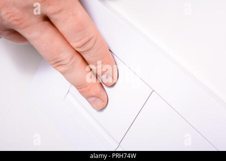 Male Hand Pressing Left Plate Of A Dual Flush Toilet For The Full Amount Of Water - Water Saving Concept - Stock Photo