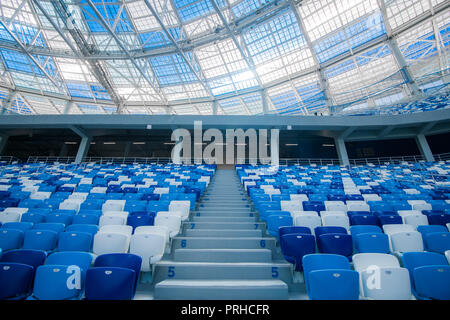 Cement stairs and blue seats inside football stadium - Stock Photo