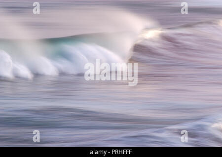 Waves rolling into shore late evening. - Stock Photo