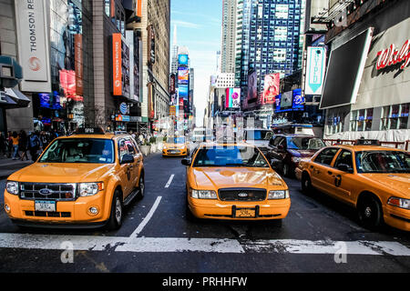 NEW YORK-NOVEMBER 6: Yellow cab and busy Time Square in Manhattan on November 6, 2013. - Stock Photo
