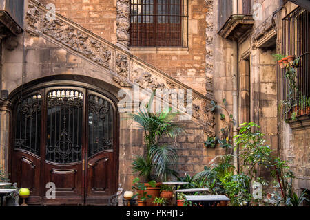 Medieval inner yard in the Gothic Quarter of Barcelona, Catalonia, Spain, Europe. Historical stone stairs, wall and beautiful ancient patterns. - Stock Photo