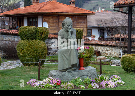 Memorial tombstone with the sculpture 'Mother' in the grounds of the  Dimcho Debelyanov House and museum in Koprivshtitsa, Central Bulgaria. - Stock Photo