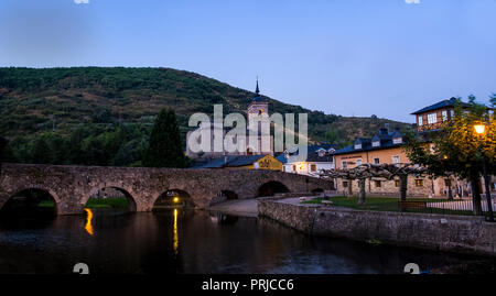Early morning in the town of Molinaseca showing a view of the Church of Saint Nicholas and the Bridge of the Pilgrims. - Stock Photo