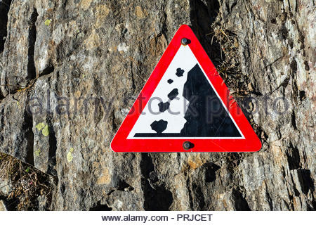 Attention rocks warning sign you often see on mountain trails in the alps. This photo was shot in Switzerland close to Andermatt. - Stock Photo