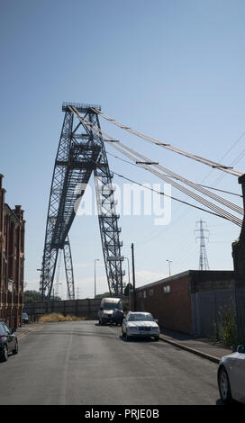 West tower and supporting cables of Newport Transporter Bridge seen from Brunel Street, Newport, UK - Stock Photo