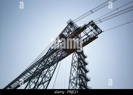 West tower and supporting cables of Newport Transporter Bridge in silhouette, Newport, UK - Stock Photo