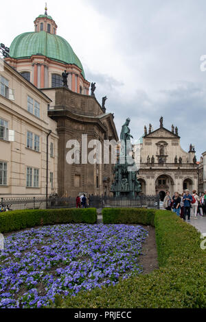 Knights of the Cross Square next to Charles Bridge and church of St. Francis in Prague, Czech Republic - Stock Photo