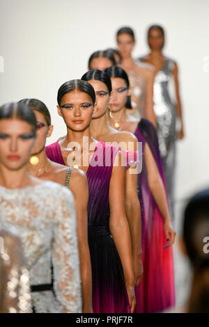 NEW YORK, NY - SEPTEMBER 06: Models walk the runway for Tadashi Shoji during New York Fashion Week: The Shows at Gallery II at Spring Studios on Septe - Stock Photo