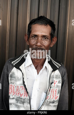Portrait of man in Banda Aceh, Sumatra, Indonesia - Stock Photo