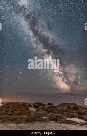 The summer Milky Way towering over the sandstone concretions and badlands at Red Rock Coulee Natural Area, in southeast Alberta. Taken July 26, 2017.  - Stock Photo