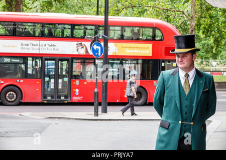 London England United Kingdom Great Britain West End City Westminster Mayfair Park Lane The Dorchester hotel luxury 5-star outside entrance porter doo - Stock Photo