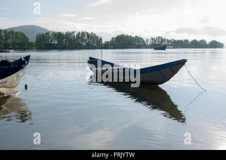small fishing boats refection on the fjord - Stock Photo