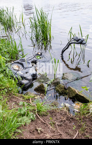 River pollution. Abandoned machinery dumped in the River Trent, Nottinghamshire, England, UK - Stock Photo
