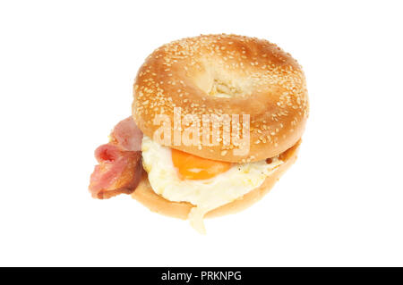 Fried egg and bacon in a bagel isolated against white - Stock Photo