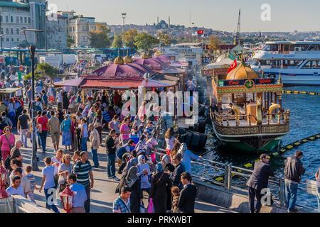 Fish sandwich boats on the Golden Horn in Eminonu, Istanbul, Turkey. - Stock Photo