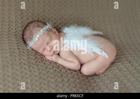 Newborn baby with angel wings - Stock Photo