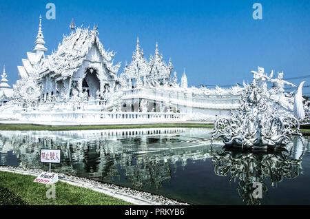 Wat Rong Kun, amazing White Temple in Chiang Rai, Thailand - Stock Photo