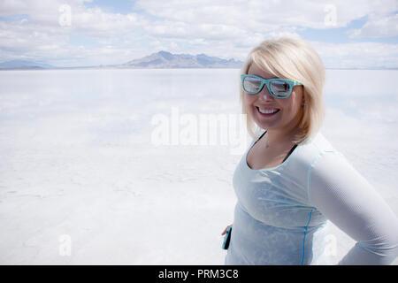 Adult female portrait standing at the Bonneville Salt Flats in Utah - Stock Photo