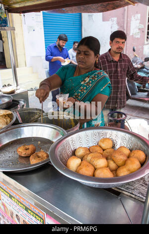 Preparing and selling Indian street food in a food stall. Photographed in Ahmedabad, Gujarat, India - Stock Photo