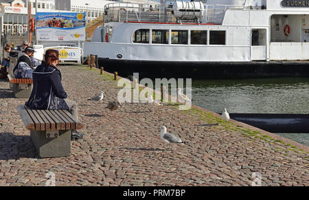 Market Square. Helsinki City Transport maintains all-year-round ferry link to Suomenlinna harbor. Passengers and seagulls - Stock Photo