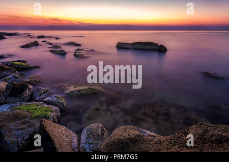 colorful and tranquility rocky coast before sunrise. - Stock Photo
