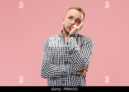 I am tired of everything. Bored man. Boring, dull, tedious concept. Human emotions, facial expression concept. Studio Isolated on trendy pink background - Stock Photo