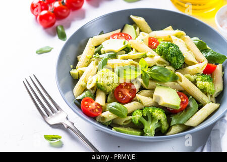 Vegan pasta penne with vegetables.  - Stock Photo