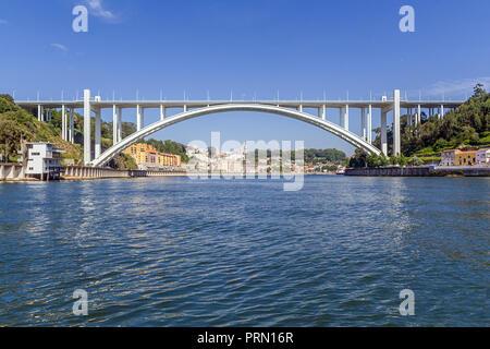 Ponte da Arrabida Bridge in Porto or Oporto city, Portugal. Connects the cities of Porto or Oporto and Vila Nova de Gaia over the Douro River - Stock Photo