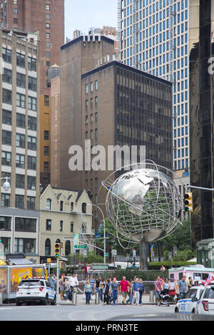 This globe by artist Kim Brandell shows the earth's continents suspended Columbus Circle by the southwest corner of Central Park. This globe by artist Kim Brandell shows the earth's continents suspended on steel rings that represent latitude and longitude lines. It stands in a plaza at the base of the Trump International Hotel & Tower near Central Park. - Stock Photo