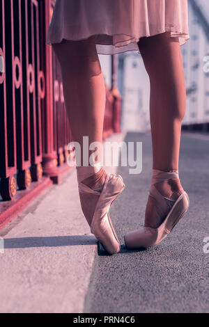 Professional female dancer wearing her pointe shoes - Stock Photo
