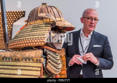 London, UK. 3rd Oct 2018. An 18th century samuri suit of armour in Jean Christophe Charbonner - Frieze Masters London 2018, Regents Park, London. It covers several thousand years of art from 130 of the world's leading modern and historical galleries. The vetted artworks spanning antiquities, Asian art, ethnographic art, illuminated manuscripts, Medieval, modern and post-war, Old Masters and 19th-century, photography and sculpture.  The fair is open to the public 04-07 October. Credit: Guy Bell/Alamy Live News - Stock Photo