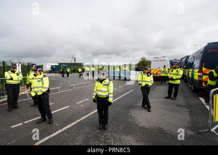 Plumpton, Blackpool, UK. 3rd Oct, 2018. Anti-fracking protester cut free from a lock-on  device after 3 day protest in the entrance to the Cuadrilla exploratorive site on Preston New Road, Little Plumpton, near Blackpool. Several protesters started the protest on Monday in support of the three anti-fracking protesters who were recently jailed and to coincide with the start of the Conservative Party Conference being held in Birmingham. Credit: Dave Ellison/Alamy Live News - Stock Photo
