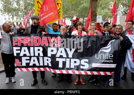London, UK, 4th October 2018. McDonald's, wetherspoons, TGI Fridays alongside Delivroo and Uber eats riders rally in Leicester Square, demanding better working conditions, and £10 an hour. Credit: Yanice Idir / Alamy Live News - Stock Photo