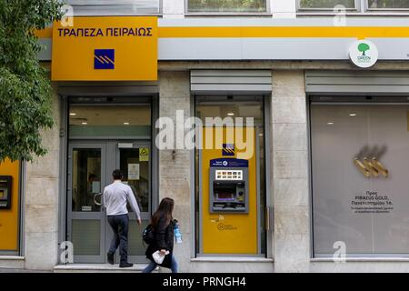 Athens, Greece. 4th Oct, 2018. Piraeus bank branch in Athens. Greek banking shares are down sharply amid investor fears over the lenders' needs to reduce their large stock of bad loans resulting from the financial crisis. The index of bank stocks was down 10 percent in Athens on Wednesday amid reports that some of the bigger banks plan to more aggressively write off bad loans. (Credit Image: © Aristidis VafeiadakisZUMA Wire) - Stock Photo