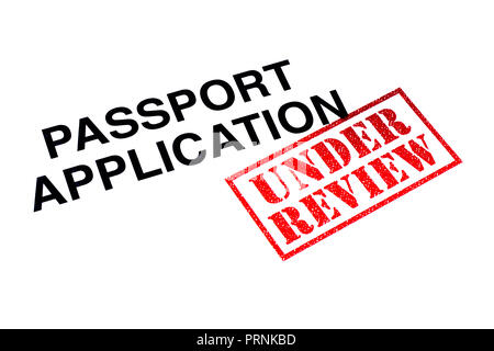 Passport Application heading stamped with a red UNDER REVIEW rubber stamp. - Stock Photo