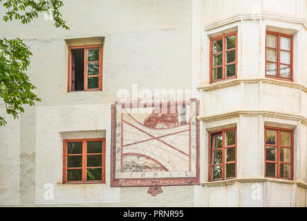 Glorenza (Glums) in South Tyrol/Trentino Alto Adige, Italy. Characteristic facade of a historic building with a painted sundial - Stock Photo