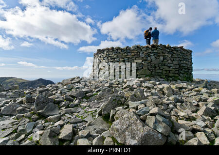 Walkers on the summit of Scafell Pike, highest Mountain in England - Stock Photo