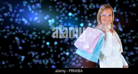 Composite image of handsome woman holding shopping bags against white background - Stock Photo