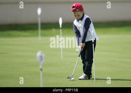 A young golfer at Royal Portrush Golf Club in Portrush,  County Antrim, Northern Ireland, Tuesday July 19th, 2011. Photo/Paul McErlane - Stock Photo