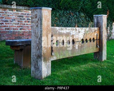 Stocks on the village green at Aldborough near Boroughbridge North Yorkshire England - Stock Photo