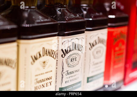 Bucharest, Romania - June 17, 2018: closeup of American Jack Daniels whiskey bottles with different flavors and label design standing on supermarket s - Stock Photo