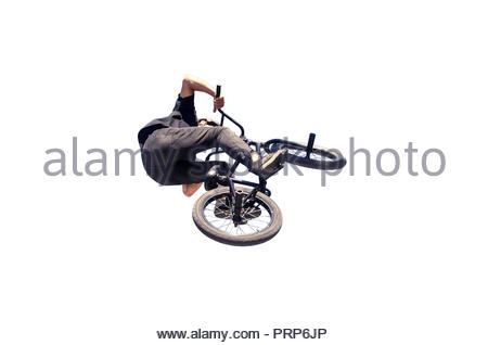 bmx rider in black performing a jump with his bycicle isolated over white - Stock Photo