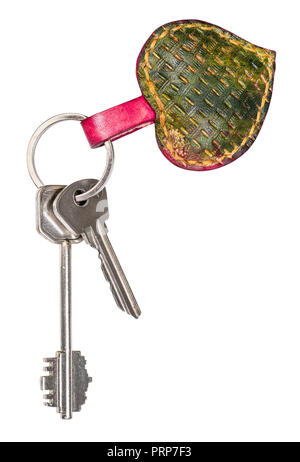 pair of keys on green colored embossed leather heart shaped key fob cutout on white background - Stock Photo