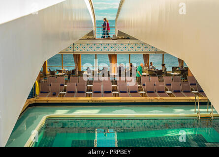 Lido Deck swimming pool under retractable roof. The Volendam, Holland America R Class cruise ship, docked at Vancouver, British Columbia, Canada. - Stock Photo
