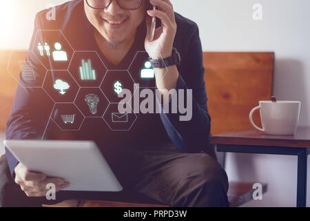 Man holding digital tablet making online shopping and banking payment. Blurred background . - Stock Photo