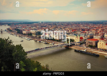 A view of the River Danube and cityscape of Budapest from the Gellert Hill above the Elizabeth Bridge in summertime - Stock Photo